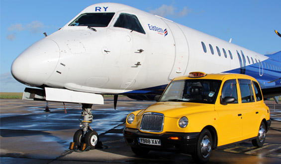 One of our taxis next to an airplane